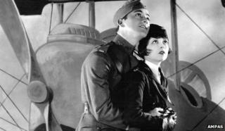 """Charles """"Buddy"""" Rogers and Clara Bow as they appear in Wings, 1927. Courtesy of Ampas."""