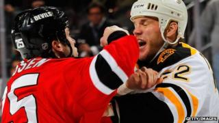 Shawn Thornton of the Boston Bruins and Cam Janssen of the New Jersey Devils fight during an NHL hockey game on January 4, 2012 in Newark, New Jersey