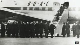 Queen Elizabeth II returns to the UK following her accession to the throne
