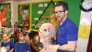 Tom MacRae with some children at Wheedon Beck Primary school