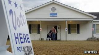 Voters leave the polling place in Fall Branch, South Carolina January 21, 2012