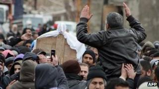 The coffin of Maher Hamad, 14, is carried during his funeral procession in the northern Lebanese village of Arida on January 22