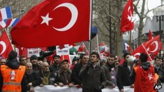Turkish citizens from France and other European countries demonstrate in Paris Saturday Jan. 21, 2012, to protest against a law that makes it a crime to deny genocide against Armenians