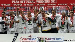 Swansea players celebrate after winning promotion to the Premier League