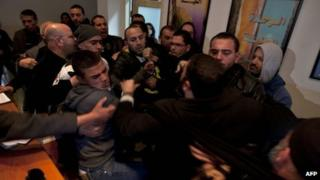 Relatives of Khaled Abu Arafah and Mohammed Totah scuffle with police inside the compound of the International Committee of the Red Cross (ICRC) in East Jerusalem (23 January 2012)