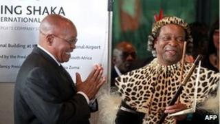 South African President Jacob Zuma (L) applauds Zulu King Goodwill Zwelithini (R) on 8 May 2010 after officially opening the Central Terminal building of Durban's new King Shaka International Airport and Dube Trade Port, north of Durban.