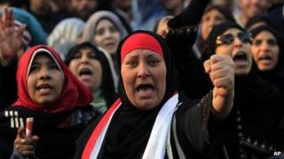 Women at a rally honouring demonstrators killed in clashes with security forces in Tahrir Square, Cairo (23 January 2012)