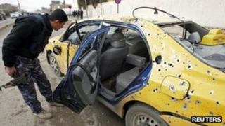 Car destroyed by bomb attack in Kirkuk