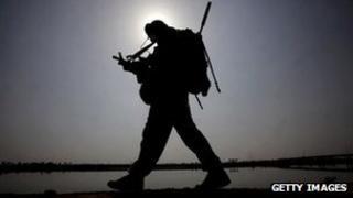 A British soldier on patrol