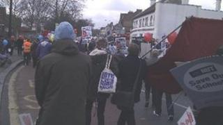 Protest march against academy plan