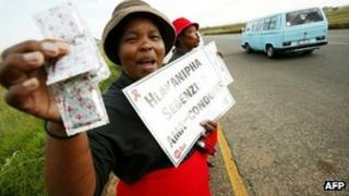 Women from the mining community pass out condoms and educational leaflets on 2 April 2004 in the Witbank District in the Gauteng Province of South Africa.