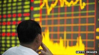 Investor looking at stock market board
