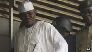 """Maj. Hamza Al-Mustapha leaves the court after a verdict in Lagos, Nigeria, on Monday, 30 Jan 2012. A judge in Nigeria has sentenced a former dictator""""s right-hand man to death over the killing of a politician""""s wife."""