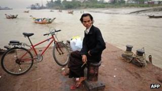 Burmese man waits to cross river near Rangoon