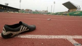 A shoe is seen inside the Port Said stadium one day after soccer supporters clashed February 2, 2012