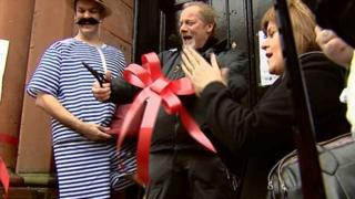 Peter Mullan cuts the ribbon to open the Govanhill baths