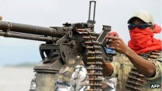 A Mend militant poses with a heavy machine-gun in the Niger Delta on September 17, 2008