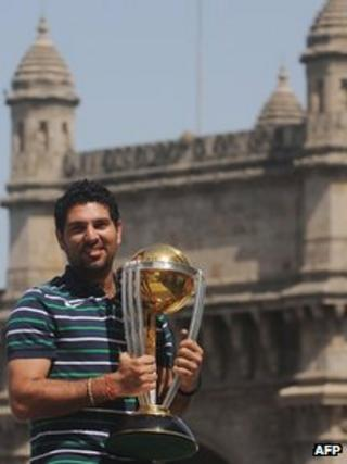 Cricketer Yuvraj Singh poses with the World Cup trophy in Mumbai in April 2011