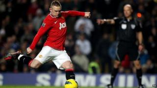 Rooney takes a penalty