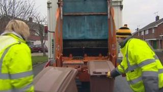 Dustbin men emptying brown bins