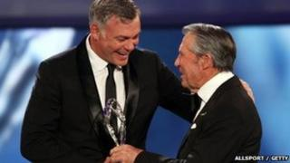 Darren Clarke receives his Laureus World Comeback of the Year trophy from Academy member Gary Player