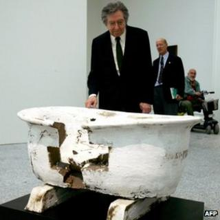 Antonio Tapies with one of his artworks