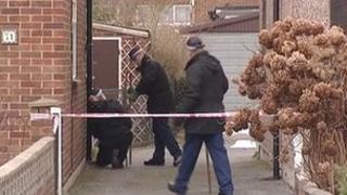 Police outside the home where the pensioner was hit
