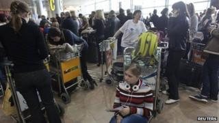 People wait at Tel Aviv's Ben-Gurion International Airport (8 January 2012)