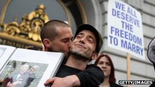 A gay couple kiss after a court in California declared the state's ban on gay marriage was unconstitutional 7 February 2012