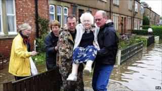 Residents of Morpeth, Northumberland leave their flooded homes following a night of rising floodwaters in the town. September 2008.