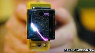 Taser gun held by a police officer