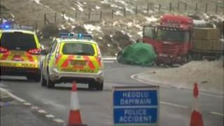Police vehicles at the scene of a collision on the A470 in Powys