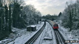 A District line Tube approaches Gunnersbury station in Chiswick earlier