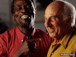 Elderly men sharing a joke