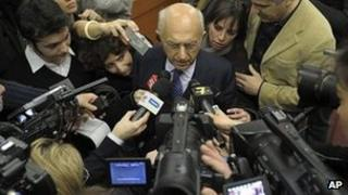 A prosecutor is surrounded by media during the asbestos trial in Turin. Photo: 13 February 2012