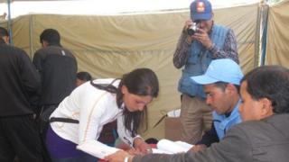 Former Maoist fighter signs her demobilisation papers