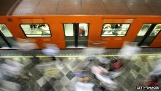 Commuters in Mexico City subway