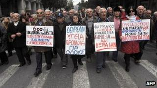 Greek pensioners march in central Athens , protesting new austerity cuts