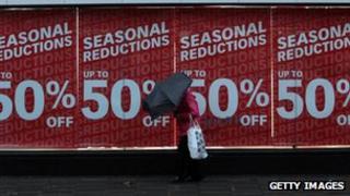 Shopper outside retail outlet