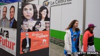 Children walk past billboards in Andorra