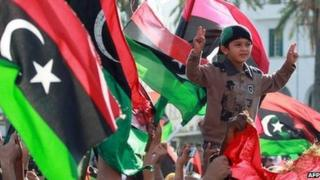 Libyans celebrate the capture of Saif al-Islam, fugitive son and one-time heir apparent of murdered leader Muammar Gaddafi, in the capital Tripoli on November 19, 2011.