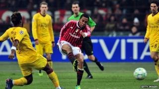 Robinho kicking and scoring in the match