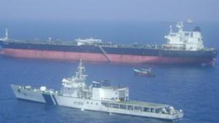 Indian warship alongside the Italian cargo vessel