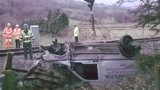 Crane lifts van out of ditch