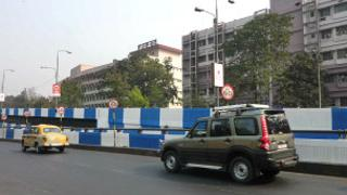 A Calcutta road divider painted blue