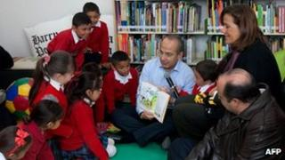 President Felipe Calderon reads to children at a public school in Ciudad Juarez