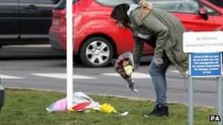 Woman lays flowers at Alvechurch School in Worcestershire