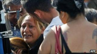 A woman cries at the scene of the killing of five taxi-drivers in Monterrey in northern Mexico