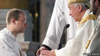 Andrew Hall (l) ordained as a priest by Archbishop Vincent Nichols