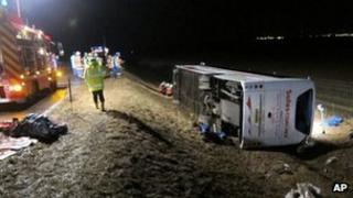 The coach involved in the crash and emergency services